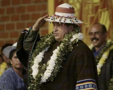 Hugo Chavez salutes the Bolivian hat