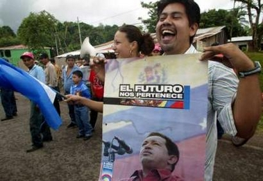 A Chavez supporter in Nicaragua cheers as Daniel Ortega's helicopter touches down near an oil depot