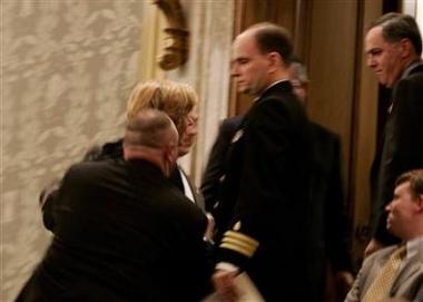Security men arresting Cindy Sheehan