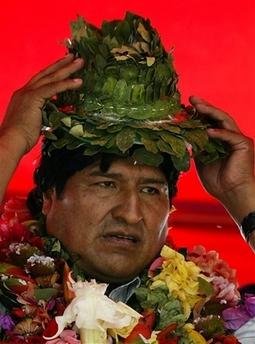Evo models a coca-leaf hat