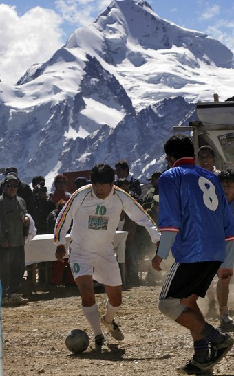 Evo Morales playing soccer at altitude