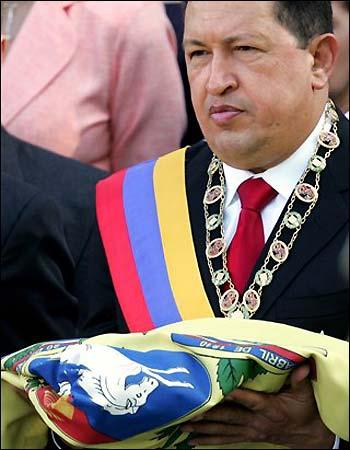 Hugo Chavez carries in the new Venezuelan flag