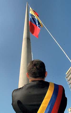 Hugo Chavez hoisting the flag