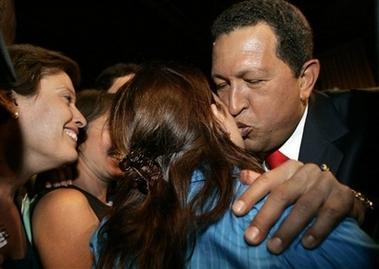 Hugo Chavez kisses a reporter hello