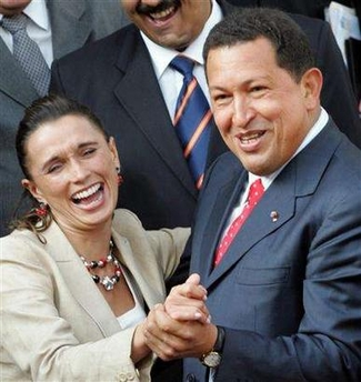 Hugo Chavez dancing with Colombian minister