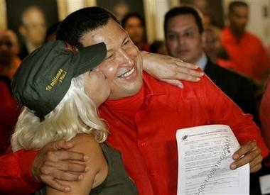 Hugo Chavez with activist Lina Ron