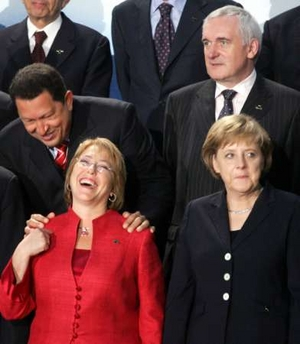 Angela Merkel is not amused! But Michelle Bachelet is. That's all that matters.
