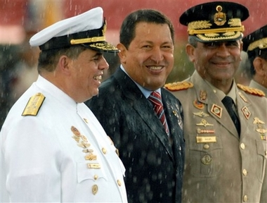 Hugo Chavez in the rain, with Generals Maniglia and Baduel