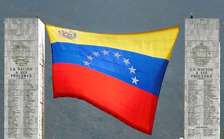 A giant version of the new flag flies between two monuments at Fuerte Tiuna, Caracas