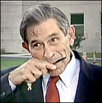 Paul Wolfowitz goobing on his comb